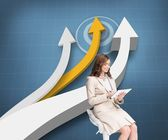 Pleased businesswoman using a tablet pc sitting on a bar chair — Stock Photo