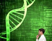 Thoughtful young businessman looking at dna spiral — Stock Photo