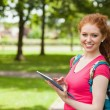 Gorgeous smiling student using tablet — Stock Photo #36166871