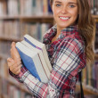 Pretty cheerful student holding books — Stock Photo