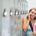 Cheerful pretty student phoning — Stock Photo