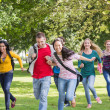 Stock Photo: College students running in the park
