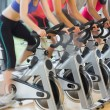Mid section of people working out at spinning class — Stock Photo #36167303
