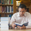 Stock Photo: Intellectual attractive mreading concentrated book