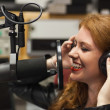 Cheerful beautiful singer recording song — Stockfoto #36167695