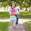 Pretty happy student carrying notebook — Foto Stock