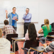 Teacher with students in the classroom — Stock Photo