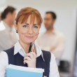 Lovely female mature student posing in classroom — Stock Photo