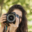 Pretty brunette woman taking a picture — Stock Photo
