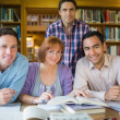 Adult students studying together in the library — Stock Photo #36168957