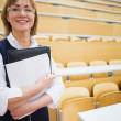 Elegant female teacher in lecture hall — Stock Photo #36169279