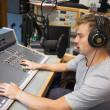 Stock Photo: Handsome focused radio host moderating