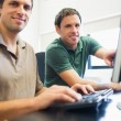 Teacher and mature student in computer room — Stockfoto #36169451