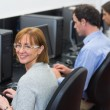 Mature students in the computer room — Stock Photo