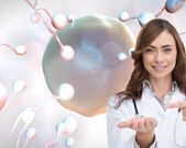 Smiling doctor pointing at something in her hand — Stock Photo