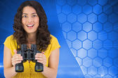 Casual young woman holding binoculars — Stock Photo