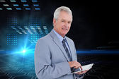 Mature tradesman with tablet computer — Stock Photo