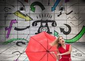 Beautiful woman wearing red dress holding umbrella — Stock Photo