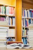 Piles of books on desk — Foto de Stock