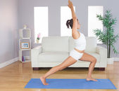 Sporty slim woman practicing yoga pose for stretching her body — Stock Photo