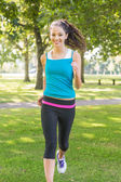Active smiling brunette jogging — Stock Photo