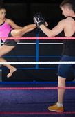 Female boxer practicing an air kick — Stock Photo