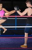 Female boxer practicing an air kick — Stock Photo