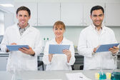 Scientists using tablet PCs in the lab — Stock Photo