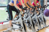 Mid section of people working out at spinning class — Stok fotoğraf