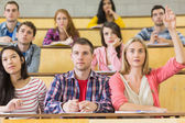 Concentrating students at the lecture hall — Stock Photo