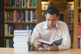 Intellectual attractive man reading concentrated a book — Stock Photo