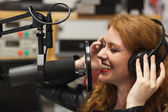 Cheerful beautiful singer recording a song — Stockfoto