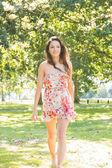 Stylish happy brunette walking — Foto Stock