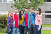Group portrait of college students in the park — Stock Photo