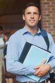 Handsome male mature student posing holding some files — Stock Photo