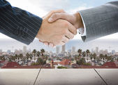 Business handshake on background of townscape — Stock Photo