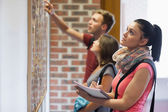 Students looking at notice board — Stock Photo