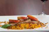 Front view of couscous dish with meat — Stock Photo