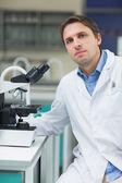 Scientific researcher with microscope in the laboratory — Stock Photo