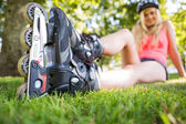 Casual attractive blonde wearing roller blades — Stock Photo