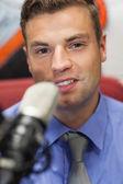 Well dressed smiling radio host moderating — Stock Photo