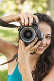 Lovely young woman taking a picture — Stock Photo