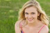 High angle view of beautiful young woman smiling at camera — Stock Photo