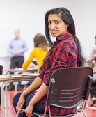 Female with blurred teachers students in classroom — Stock fotografie