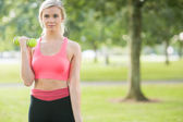 Active pretty blonde lifting dumbbells — Stock Photo