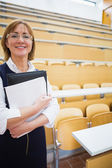 Elegant female teacher in lecture hall — Foto Stock
