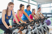 Determined people working out at spinning class — Foto Stock
