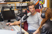 Attractive content radio host interviewing a guest — Stock Photo