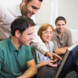 Teacher and mature student in computer room — Stock Photo #36176889