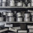 Stock Photo: Shelf full of pans